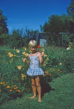 Age eight, those same yellow day lilies still pool in my gardens today