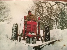 Dad, out plowing Cedar Ridge Road on the tractor in 1953.