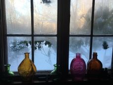 Antique bottles in Mom's kitchen window in Ct.